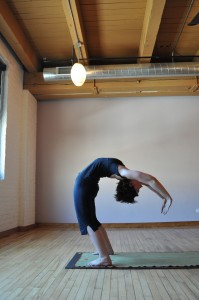 Ellie rocks the back bend. Photo by Anna Bonick